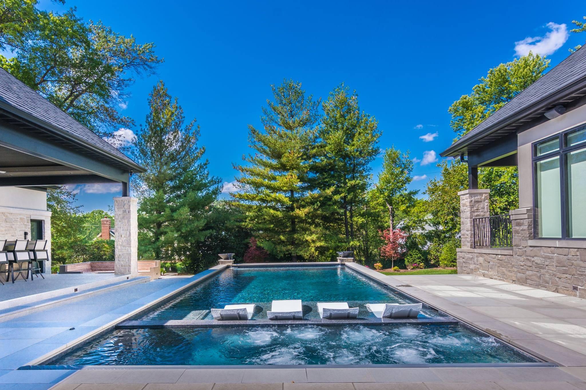 Exterior custom home frontenac pool r e a homes st for A e custom homes